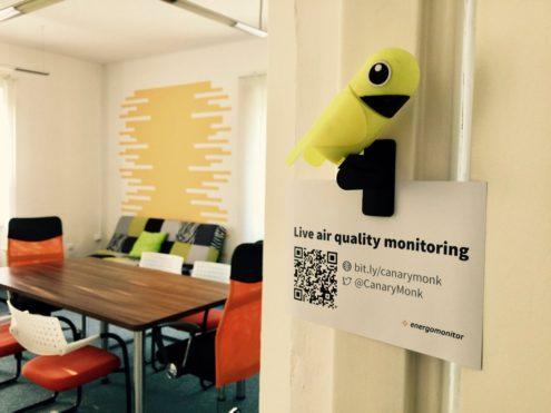 Airsense sensor hanging on a door frame at Energomonitor's office